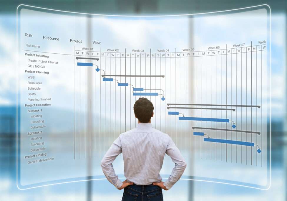 Project manager looking at AR screen with Gantt chart schedule or planning showing tasks and deadlines